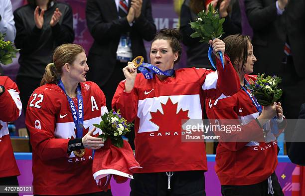 Gold medalists Hayley Wickenheiser of Canada Natalie Spooner and MariePhilip Poulin of Canada celebrate during the medal ceremony after defeating the...