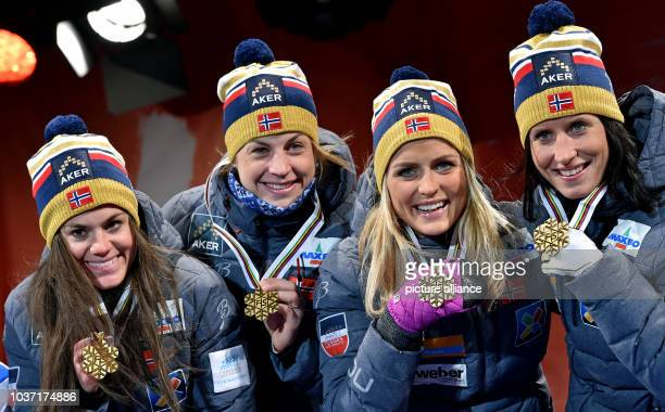 Gold medalists Heidi Weng Astrid Uhrenholdt Jacobsen Therese Johaug and Marit Bjoergen of Norway smile during the medal ceremony forthe cross country...