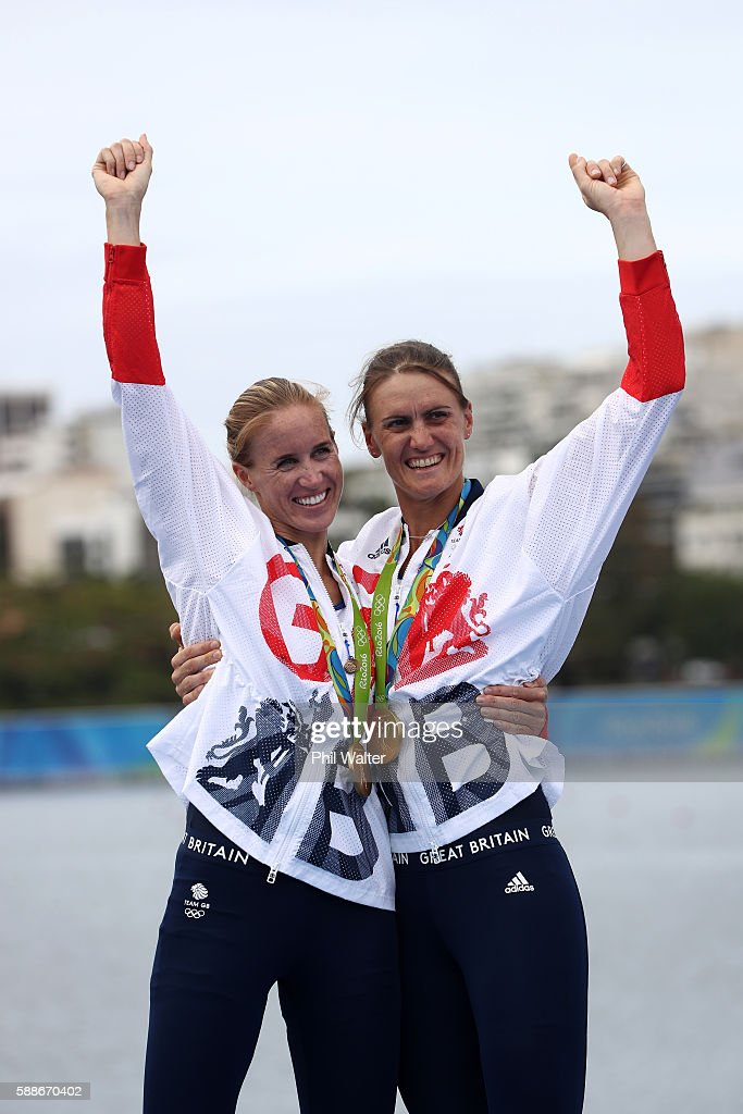Gold medalists Helen Glover (L) and Heather Stanning (R) of Great Britain celebrate on the podium at the medal ceremony for the Women's Pair on Day 7 of the Rio 2016 Olympic Games at Lagoa Stadium on August 12, 2016 in Rio de Janeiro, Brazil.