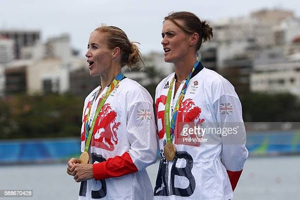 Gold medalists Helen Glover and Heather Stanning of Great Britain celebrate on the podium at the medal ceremony for the Women's Pair on Day 7 of the...