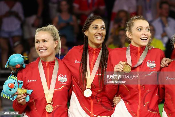 Gold medalists Helen Housby Geva Mentor and England celebrate during the medal ceremony for the Netball Gold Medal Match on day 11 of the Gold Coast...