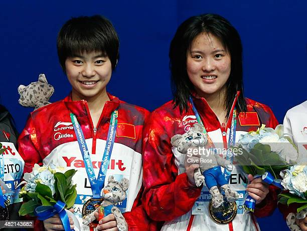 Gold medalists Huixia Liu and Ruolin Chen of China pose with the medals won in the Women's 10m Platform Synchronised Final on day three of the 16th...