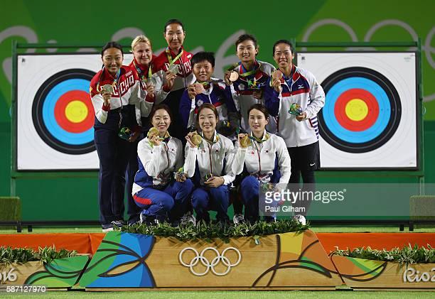 Gold medalists Hyejin Chang Misun Choi and Bobae Ki of Korea Silver medallist Ksenia Perova Tuiana Dashidorzhieva and Inna Stepanova of Russia and...