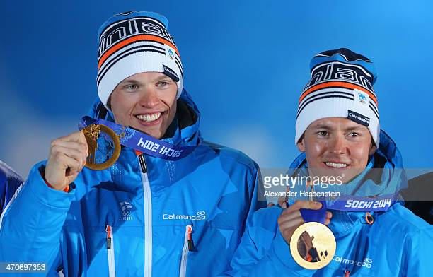 Gold medalists Iivo Niskanen and Sami Jauhojaervi of Finland celebrate during the medal ceremony for the Cross Country Men's Team Sprint celebrate on...