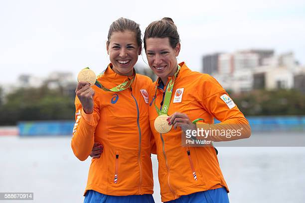 Gold medalists Ilse Paulis and Maaike Head of the Netherlands pose for photographs on the podium at the medal ceremony for the Lightweight Women's...