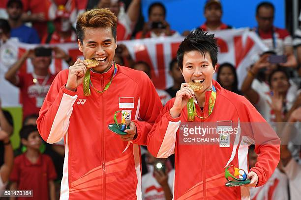 Gold medalists Indonesia's Tontowi Ahmad and Indonesia's Liliyana Natsir hold their medals on the podium following the mixed doubles Gold Medal...