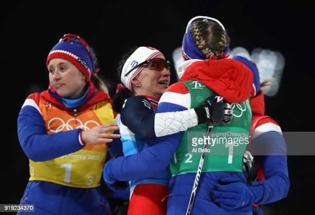 Gold medalists Ingvild Flugstad Oestberg Astrid Uhrenholdt Jacobsen Ragnhild Haga and Marit Bjoergen of Norway celebrate after the Ladies' 4x5km...