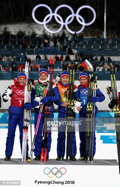Gold medalists Ingvild Flugstad Oestberg Astrid Uhrenholdt Jacobsen Ragnhild Haga and Marit Bjoergen of Norway celebrate during the victory ceremony...