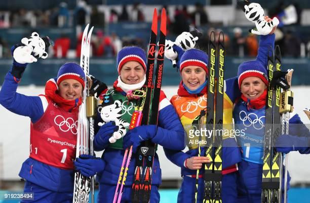 Gold medalists Ingvild Flugstad Oestberg Astrid Uhrenholdt Jacobsen Ragnhild Haga and Marit Bjoergen of Norway celebrate during the victory ceremony...