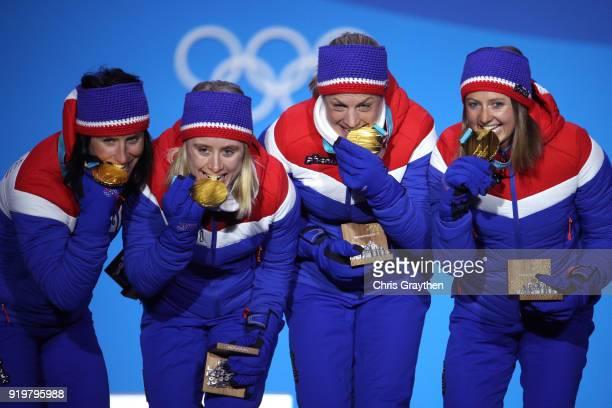 Gold medalists Ingvild Flugstad Oestberg Astrid Uhrenholdt Jacobsen Ragnhild Haga and Marit Bjoergen of Norway celebrate during the medal ceremony...