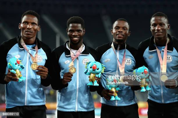 Gold medalists Isaac Makwala Onkabetse Nkobolo Baboloki Thebe and Leaname Maotoanong of Botswana celebrate during the medal ceremony for the Men's...