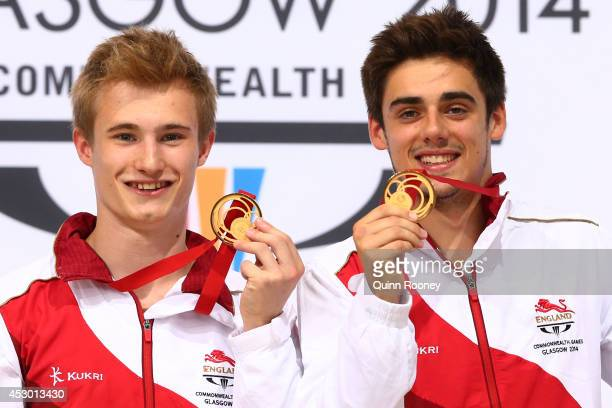Gold medalists Jack Laugher and Chris Mears of England pose during the medal ceremony for the Men's Synchronised 3m Springboard Final at Royal...