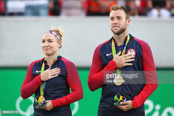 Gold medalists Jack Sock and Bethanie MattekSands of the United States pose on the podium during the ceremony for the mixed doubles on Day 9 of the...