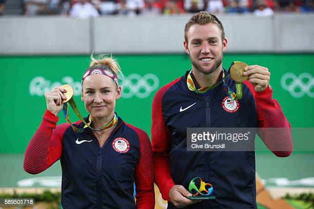 Gold medalists Jack Sock and Bethanie Mattek-Sands of the United States pose on the podium during the ceremony for the mixed doubles on Day 9 of the...