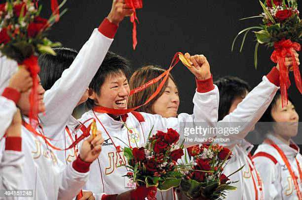 Gold medalists Japan celebrates on the podium at the medal ceremony for the softball after the women's grand final gold medal softball game between...