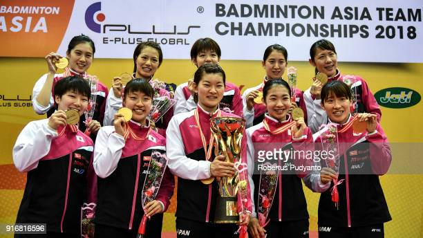 Gold medalists Japan team celebrate on the podium during Women's Team awarding ceremony of the EPlus Badminton Asia Team Championships 2018 at Sultan...