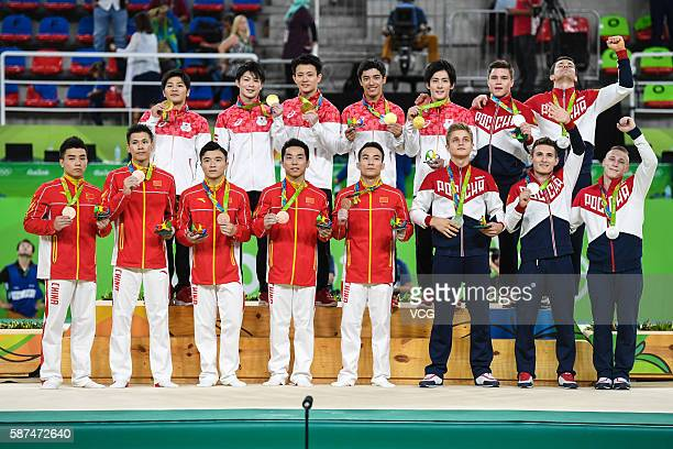 Gold medalists Japanese members silver medalists Russian members and bronze medalists China members pose for photographs after the medal ceremony for...