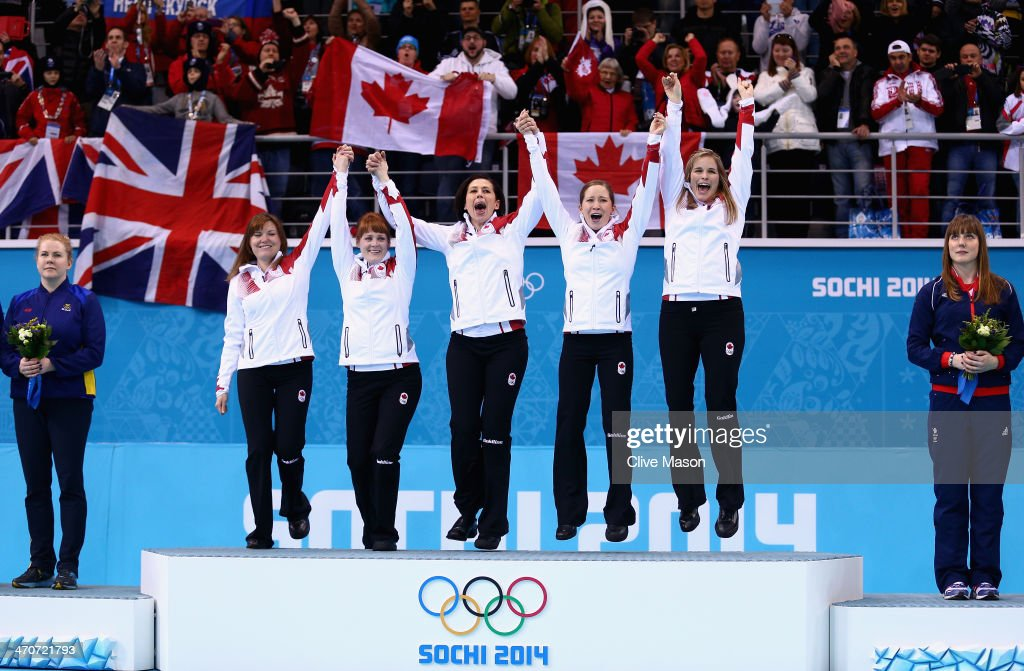 Gold medalists Jennifer Jones (R), Kaitlyn Lawes (2nd R), Jill Officer (C), Dawn McEwen (2nd L) and Kirsten Wall (L) of Canada celebrate during the flower ceremony for the Gold medal match between Sweden and Canada on day 13 of the Sochi 2014 Winter Olympics at Ice Cube Curling Center on February 20, 2014 in Sochi, Russia.
