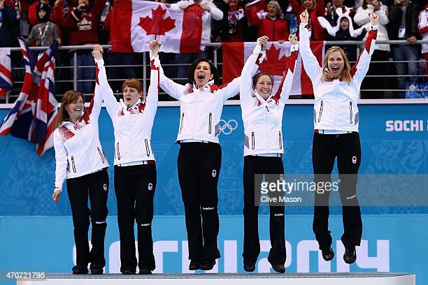 Gold medalists Jennifer Jones Kaitlyn Lawes Jill Officer Dawn McEwen and Kirsten Wall of Canada celebrate during the flower ceremony for the Gold...