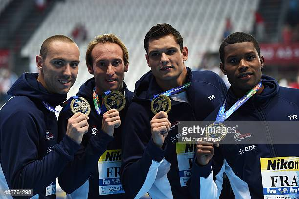 Gold medalists Jeremy Stravius Fabien Gilot Florent Manaudou and Mehdy Metella of France poses during the medal ceremony for the Men's 4x100m...