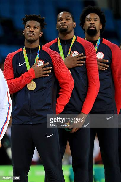 Gold medalists Jimmy Butler, Kevin Durant, and DeAndre Jordan of the United States stand on the podium for the National Anthem following the Men's...