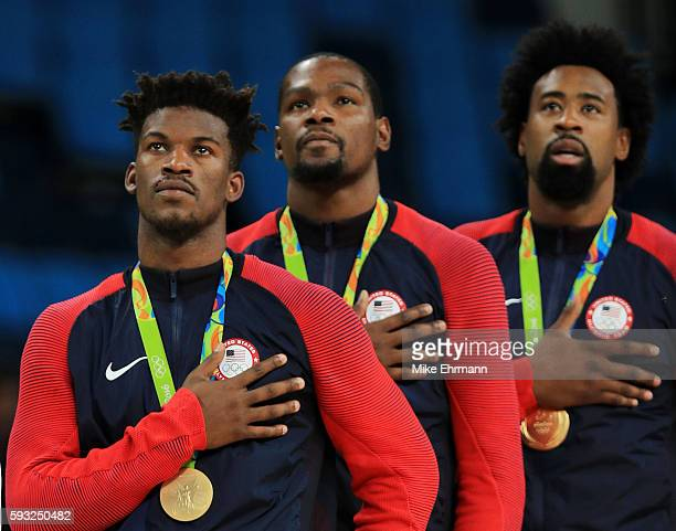 Gold medalists Jimmy Butler Kevin Durant and DeAndre Jordan of the United States stand on the podium for the National Anthem following the Men's Gold...