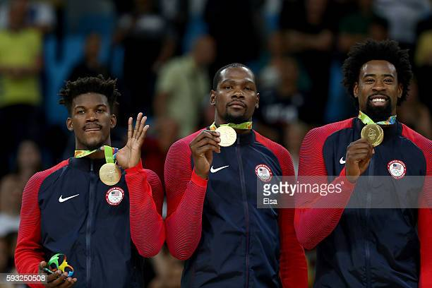 Gold medalists Jimmy Butler, Kevin Durant, and DeAndre Jordan of the United States stand on the podium after defeating Serbia in the Men's Gold medal...