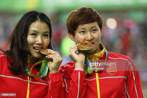 Gold medalists Jinjie Gong and Tianshi Zhong of Team China pose for photographs on the podium at the medal ceremony for the Women's Team Sprint on...
