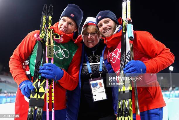 Gold medalists Johannes Hoesflat and Martin Johnsrud Sundby of Norway celebrate with Norwegian politician Trine Skei Grande after the Cross Country...