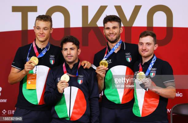 Gold medalists Jonathan Milan, Francesco Lamon, Filippo Ganna and Simone Consonni of Team Italy, pose for a photograph on the media press conference...