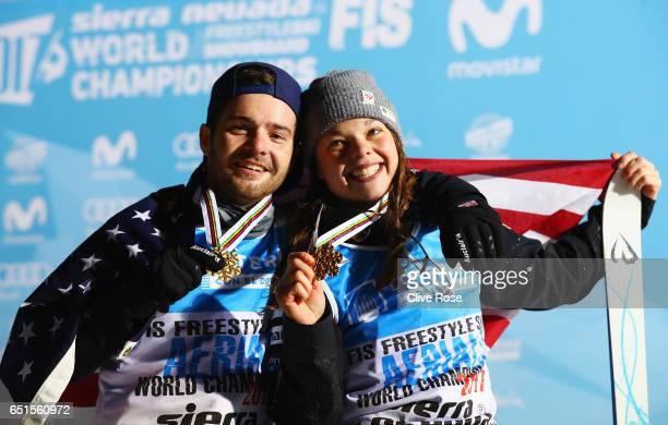 Gold medalists Jonathon Lillis of the United States and Ashley Caldwell of the United States celebrate on the podium during the medal ceremony for...