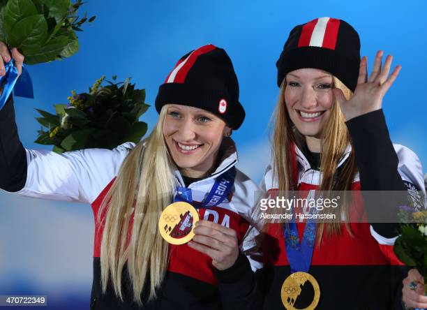 Gold medalists Kaillie Humphries and Heather Moyse of Canada team 1 celebrate during the medal ceremony for the Women's Bobsleigh on day thirteen of...
