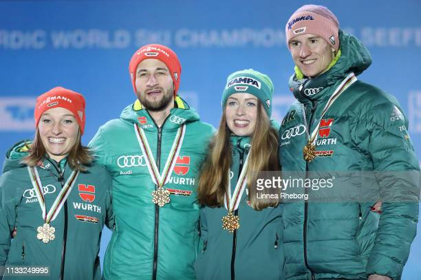 Gold medalists Katharina Althaus of Germany Markus Eisenbichler of Germany Juliane Seyfarth of Germany and Karl Geiger of Germany celebrates with...