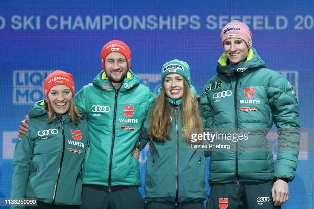 Gold medalists Katharina Althaus of Germany Markus Eisenbichler of Germany Juliane Seyfarth of Germany and Karl Geiger of Germany pose for photos...