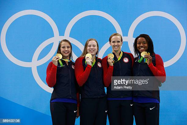 Gold medalists Kathleen Baker, Lilly King, Dana Vollmer, Simone Manuel of the United States celebrate on the podium during the medal ceremony for the...