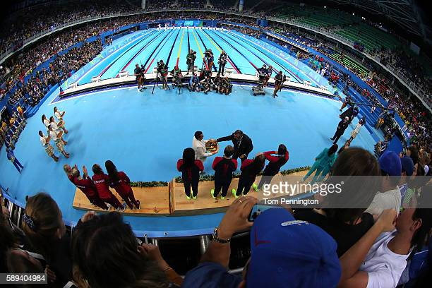 Gold medalists Kathleen Baker Lilly King Dana Vollmer Simone Manuel of the United States celebrate on the podium during the medal ceremony for the...