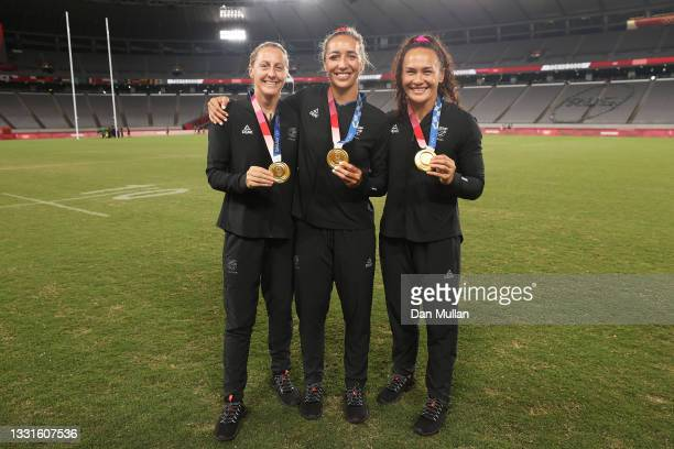 Gold medalists Kelly Brazier, Sarah Hirini and Portia Woodman of Team New Zealand celebrate with their gold medals after the Women's Rugby Sevens...