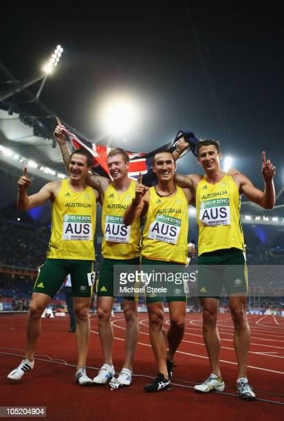 Gold medalists Kevin Moore Joel Milburn Sean Wroe and Brendan Cole of Australia celebrate after the men's 4 x 400 relay final at Jawaharlal Nehru...