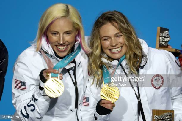 Gold medalists Kikkan Randall and Jessica Diggins of the United States celebrate during the medal ceremony for CrossCountry Skiing Ladies' Team...