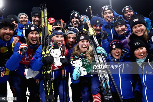 Gold medalists Kikkan Randall of the United States and Jessica Diggins of the United States celebrate with coaches and team mates after the Cross...