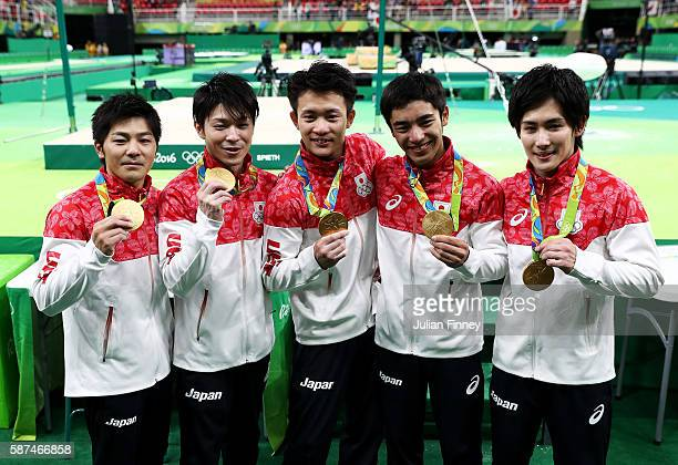 Gold medalists Koji Yamamuro Kohei Uchimura Yusuke Tanaka Kenzo Shirai and Ryohei Kato of Japan pose for photogrpahs with their medals at the medal...