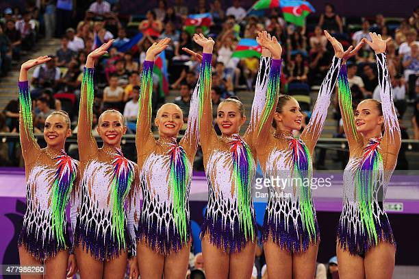 Gold medalists Ksenya Cheldishkina Maria Kadobina Valeriya Pischelina Arina Tsitsilina and Hanna Dudzenkova of Belarus celebrate prior to receiving...