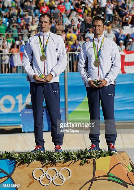 Gold medalists Ladislav Skantar and Peter Skantar of Slovakia celebrate on the podium at the medal ceremony for the Men's Canoe Double on Day 6 of...