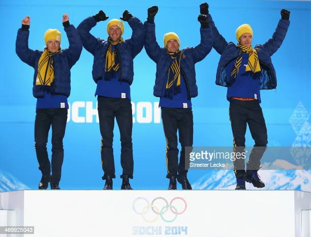 Gold medalists Lars Nelson, Daniel Richardsson, Johan Olsson and Marcus Hellner of Sweden celebrate on the podium during the medal ceremony for the...