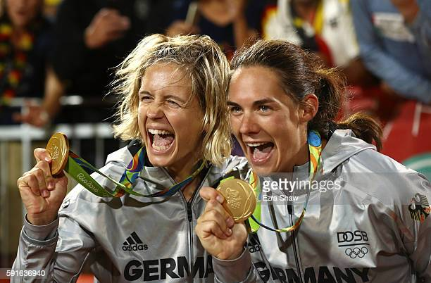 Gold medalists Laura Ludwig and Kira Walkenhorst of Germany pose on the podium during the medal ceremony for the Women's Beach Volleyball on day 12...