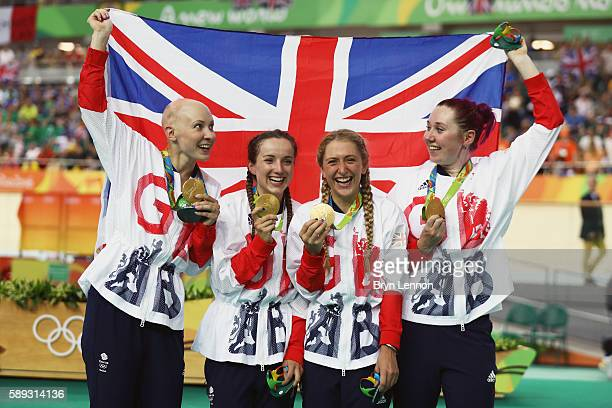 Gold medalists Laura Trott Joanna RowsellShand Katie Archibald Elinor Barker of Great Britain celebrate on the podium at the medal ceremony for the...