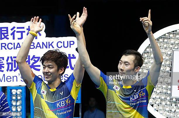 Gold medalists Lee Yong Dae and Yoo Yeon Seong of South Korea attend the award ceremony of the men's doubles final at the 2016 Badminton Asia...