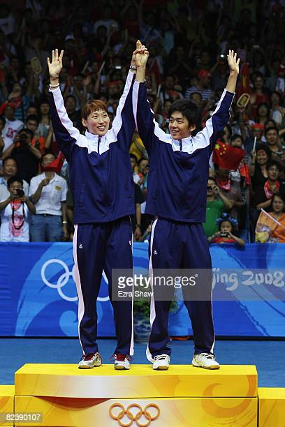 Gold medalists Lee Yongdae and Lee Hyojung of South Korea celebrate winning the Mixed Doubles Gold Medal Match against Nova Widianto and Liliyana of...