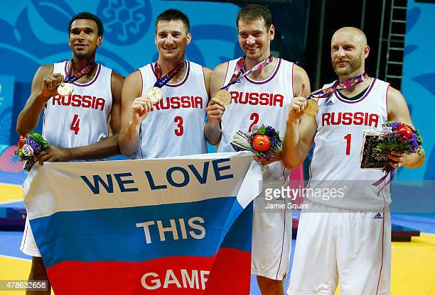 Gold medalists Leopold Lagutin Andrey Kanygin Aleksandr Pavlov and Ilia Aleksandrov of Russia stand on the podium during the medal ceremony for the...