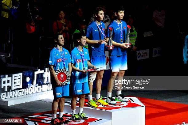 Gold medalists Li Junhui and Liu Yuchen of China and silver medalists Hiroyuki Endo and Yuta Watanabe of Japan pose during the award ceremony for...